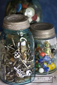 Love interesting things to fill my old mason jars with...antique marbles and buttons give lots of color. Another favorite - collecting antique keys.