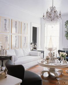 TRY: A gallery wall of fashion sketches like MARK BADGLEY AND JAMES MISCHKA, whose home was featured in ELLE DECOR in May 2002.