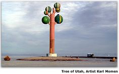 Tree of Utah  An abstract artistic sculpture called Metaphor: The Tree of Utah stands of the edge of I-80 on the barren Bonneville Salt Flats west of Salt Lake City. Swedish artist Karl Momen created the 87-foot high tree between 1982-1986. He financed the project himself to bring bold color and beauty to the stark, flat, salty landscape. The sculpture is made of 225 tons of cement, almost 2,000 ceramic tiles and five tons of welding rod, and tons of minerals and rocks native to Utah.