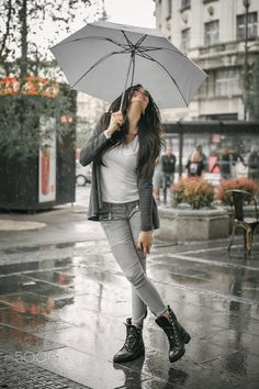 Happy smiling woman under umbrella in rain by guruxox on 500px