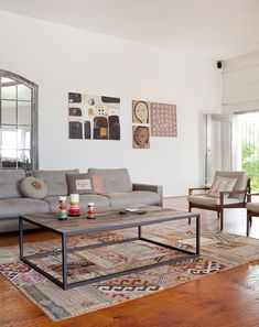 Main living space. Sofa from Jardan, cushions designed by Emmanuelle (Nell Design), artwork from left - Two Lovers by Ian Shadwell, portraits a from trip to Bali, Aboriginal painting bought in Paris long before Emmanuelle moved to Australia!  Photo – Felix Forest, Production – Lucy Feagins / The Design Files.