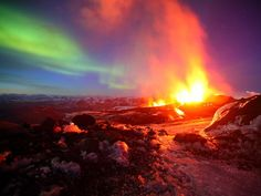 Aurora borealis (Northern Lights) and volcanic eruption, Iceland.