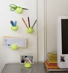 OMG...how neat is this? Never knew tennis balls were so versatile. ReadyMade is the best! I used to get their magazine...but sadly, they stopped production :-(