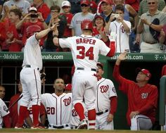 Washington Nationals' Bryce Harper (34) celebrates his solo home run during the second inning of a baseball game against the Philadelphia Phillies at Nationals Park, Friday, May 22, 2015, in Washington. - © AP Photo/Alex Brandon