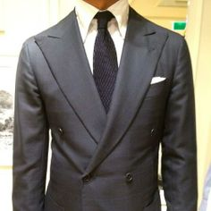 Ricardo from Oger in a Viola Milano Navy Zig Zag knitted tie.