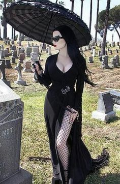 Black parasol, sexy Inny outy number very fab. Too much leg and boobage for my taste but would be easy to tailor.