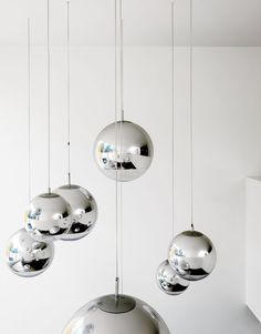 Bruce worried about what to put in the double-height space above the kitchen table—–until he found these Tom Dixon–designed mirror balls.