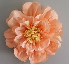 Our handmade 20 inch tissue paper flower can be adhered to any surface as a decor piece. Our flowers comes pre-assembled, but requires to be bloomed open. Instructions will be included. You pick the c