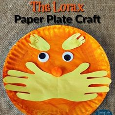 The Lorax is one of our favorite Dr. Seuss books. This is a simple paper plate craft we made with my toddler's little handprints. #drseuss #raisinglittlesuperheroes #drseussday by raisinglittlesuperheroes