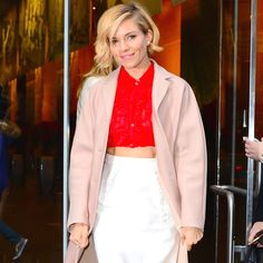 Who: Sienna Miller What: Blush and Red Why: The actress succeeds in bringing a welcome brightness to winter chill in a blush coat, red cropped top and white pencil skirt by Miu Miu. It must be said, her hair lends the perfect element to this Hitchkockian update. Get the look now: Miu Miu coat, $8,670, net-a-porter.com. Getty Images  - HarpersBAZAAR.com