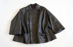 Hello Im glad youre here PANDORA FASHION  I offer vintage GIANNI VERSACE lather coat AUTHENTIC !  color:black silver stds Made in Italy size on tag-no tag. Oversize 100% leather trapeze cut used in very good condition   total length 78 cm/ 30,71 inch width armpit to armpit 88 cm/34,65 inch    If you have any question write to me   JOIN ME ON FACEBOOK  http://facebook.com/PandoraFashionVintage   More photos: https://picasaweb.google.com/11442216481532179...