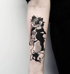 Abstract illustrative tattoo on the right inner forearm.