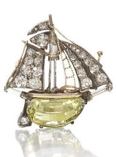 A Victorian diamond galleon brooch, circa 1900. In full sail, set with old brilliant-cut diamonds, with gold wirework rigging and crow's nest, the main-mast, bowsprit and boom, each as a facetted diamond baton, with shaped briolette-cut diamond hull and old brilliant-cut diamond rudder, mounted in silver and gold, detachable brooch fitting, cased by Carrington & Co Ltd. #Victorian #galleon #brooch