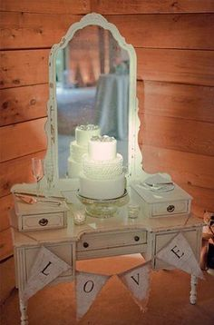 Always wanted to use an old vanity in the wedding, just didn't know what to use it for. Cake display would be cute!