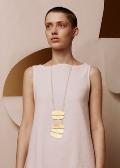 "Minimalist necklace by Waif. ""Inspired by those weird little stacks of pebbles you find on mountains, this necklace is a golden totem pole of amorphous, oblong shapes"". Brass Jewelry, Ceramic Jewelry, Body Jewelry, Pendant Jewelry, Jewelry Art, Jewelery, Jewelry Necklaces, Jewelry Design, Diamond Necklaces"
