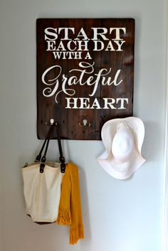 """""""Start each day with a grateful heart"""" Wood Sign With Hooks {customiza - Aimee Weaver Designs. Awesome for by the back door! Love Wood Sign, Diy Wood Signs, Custom Wood Signs, Pallet Signs, Rustic Signs, Rustic Wood, Bible Verse Canvas, Wood Artwork, Pallet Art"""