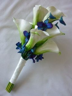 A hint of something blue in the groom's boutonniere complete with stunning orchids.