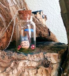 Hey, I found this really awesome Etsy listing at http://www.etsy.com/listing/97045438/tiny-totoro-in-the-rain-terrarium
