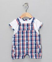 Your little guy has waited for a chance to frolic in the backyard, so make those sunny days count by dressing him in this hip set. The coordinating look and ever-present comfort are a winning combination. He'll be looking his most handsome making everything he does from sliding down the slide to swinging on the swings a great photo op!  Includes tee and shortalls