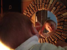 90 corks, 10 inch round mirror, patch together some cardboard and you have yourself a nice-looking mirror-  Especially nice if you have a little cherub face to peer into it :-)