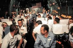 Amercian POWs from North Vietnamese prison camps aboard the Hanoi Taxi on a flight from Hanoi, North Vietnam to Clark Air Base, Philippines in March 1973