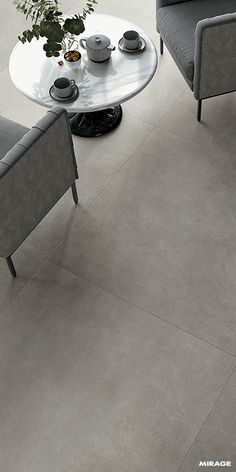 Simple, neutral and with an appealing material quality: these are the defining features that have been shaped into Glocal, the new smooth concrete collection in Mirage porcelain stoneware. Floor Design, Tile Design, House Design, Stone Flooring, Kitchen Flooring, Modern Flooring, Smooth Concrete, Outdoor Tiles, Concrete Tiles
