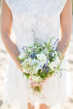 bouquet with a touch of blue // photo by Bubblerock // http://ruffledblog.com/bordeaux-beach-wedding-inspiration