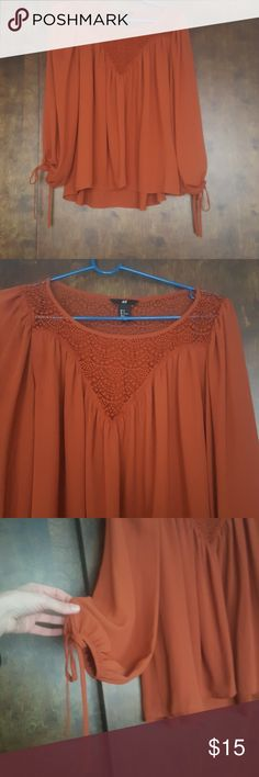 H&M bohemian blouse Beautiful bohemian top with embellishment on the chest area and cute tie details on the wrist. Worn in excellent condition. Its a maroon/rust color H&M Tops Blouses