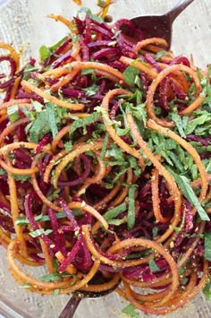 Fresh beets are made into noodles, tossed with a simple orange vinaigrette, and topped with fresh mint and pistachios. This sprialized beet salad is quick, easy, and a fun way to eat your veggies!