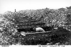 Ohrdruf death camp, Germany, Germans forced into digging graves for the death camp dead, 1945.