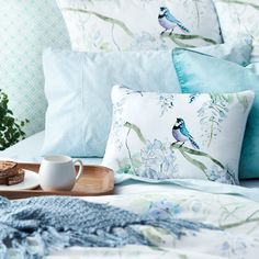Wake up in a restful haven with the Japanese Wisteria quilt cover. Printed on luxurious 360 thread count cotton sateen, the quilt cover features hummingbirds and dragonflies fluttering around blooming wisteria. #bedroom #quiltcover #bedbathntable