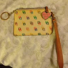 Dooney & Bourke IT wristlet Very cute Dooney wristlet from their IT collection years ago. There's a small blemish as seen in one of the pics, otherwise very good used condition. I'm raising $ for my medical bills...please make offer.  Thx! Dooney & Bourke Accessories