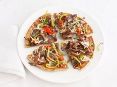 Philly Cheesesteak Pizzas Recipe : Food Network Kitchens : Food Network.....my entire family LOVED this!!!!!