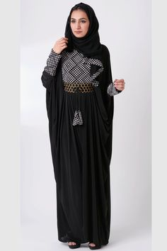 Abaya design with mesmerizing white geometric embroidery and signature pleated skirt. A faux belt center focuses the entire look and the inside tie lets you choose your own fit. Matching detail on aba