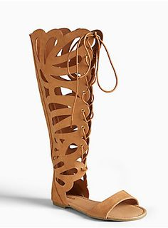 <p>Walk, run, sprint, whatever you're into, get to these summery sandals as quickly as possible! Scalloped tan faux suede is set for flashing some leg, while fighting the good fight in a knee high gladiator sandals. The lace up front is totally adjustable, so you can walk it out with ease.</p>  <ul> 	<li>Man-made materials</li> 	<li>Imported</li> </ul>