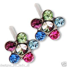 Ear piercing studs. Just in! Bright Rainbow Daisy Flower Silver Studs Studex System 75 Ear Piercing Earrings. Only $9.99!