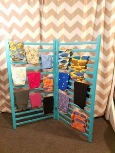 LuLaRoe leggings rack! Spray painted crib rails connected with hinges. *Photo property of Abbie Schmitt.*