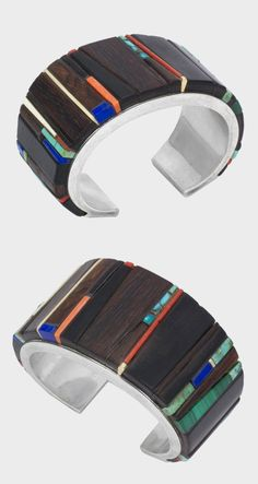 Cuff bracelet | Charles Loloma.  Silver inlaid with ironwood, turquoise, lapis, malachite, coral and fossil ivory