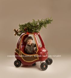 Valerie Meeker....  Jazzed up Cozy Coupe for Christmas Pictures