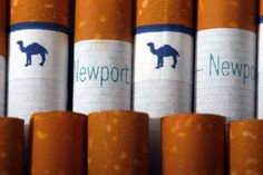 Camel, a Reynolds American brand, and Newport, a Lorillard brand, cigarettes are arranged for a photo Tuesday, July 15, 2014 in Philadelphia. Reynolds American Inc. is planning to buy rival Lorillard Inc. for about $25 billion in a deal to combine two of the nation's oldest and biggest tobacco companies, the companies announced Tuesday.