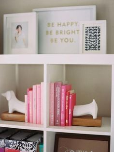 30 Ways to Make Every Room in Your House Prettier - Pink books and cute prints on a white bookshelf