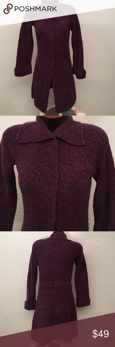 Italian Yarn Cardigan. Beautiful color. Soft material. Front pockets. Snap buttons on front. I do not have the tie that originally came with it for that waist. It looks better without so I never used it. It's in excellent condition! Will fit a M or L as long as you don't button the front. Damask Sweaters Cardigans