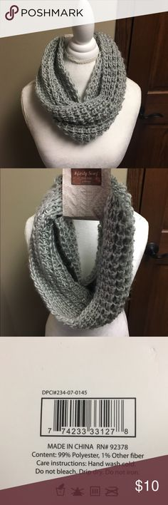 Grey knit scarf NWT Gorgeous grey sparkly knit infinity scarf. It's perfect for the winter. It is new with tags.    🌸NO TRADES🌸 🌸OFFERS ARE WELCOME 🌸 🌸FEEL FREE TO ASK QUESTIONS🌸 🌸I DO NOT MODEL🌸 Accessories Scarves & Wraps
