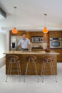 Name: Jason WeinbeckLocation: Richfield, MinnesotaSize: 1,280 square feetYears lived in: 2 Jason Weinbeck fell in love with ranch style housing and after much searching, found one ready for some renovation in 2007. Since then he has transformed this fabulous piece of Mid Century architecture into an open, airy and modern space of his own. Plus, he did it all on a limited budget with hands on diy and is the man to beat, when it comes to finding a bargain...