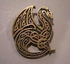"""CELTIC DRAGON  This is my new bronze dragon, adorned with Celtic style knotwork. It measures 2"""" by 1 3/4"""" and is available as a brooch or as a pendant."""