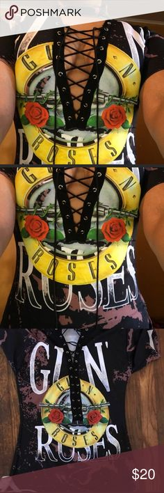 Guns and roses lace up shirt This shirt lace up but has an unraveling string that you might have to burn or cut it in order to lace it up if you take it out of holes. Size medium. Tops Tees - Short Sleeve