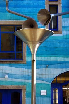 """Wall Plays Music Close up view ~ When It Rains According to Atlas Obscura, """"when the rain starts to fall, this colorful drain and gutter system attached to the outside of a building in the Neustadt Kunsthofpassage turn into charming musical instruments. The Funnel Wall is one of the strangest and most enjoyable attractions in Dresden's student district in the new town."""