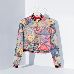 As seen on the runway, a colourful patchwork design defines this luxurious jacket. A limited-edition piece from Hilfiger Collection. Patchwork Fabric, Patchwork Designs, Quilted Clothes, Batik Fashion, Quilted Jacket, Quilted Coats, Tommy Hilfiger Women, Sustainable Fashion, Jackets For Women