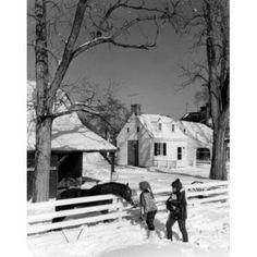 Pair of children feeding horse in winter scenery Canvas Art - (18 x 24)