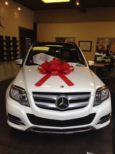 Mercedes Benz GLK winter event with red bows !
